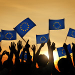 People Waving European Union Flags